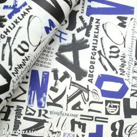 Papier tassotti motifs écritures noir et bleu
