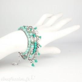 Bracelet Cheny's multi-rangs bohème chic vert émeraude avec pompom - attache réglable en métal argent