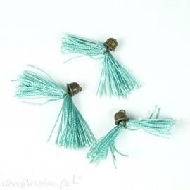 Apprêt Pompon en fil turquoise