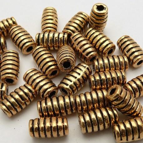 Perle métal cylindre ciselé vieil or 17x7mm
