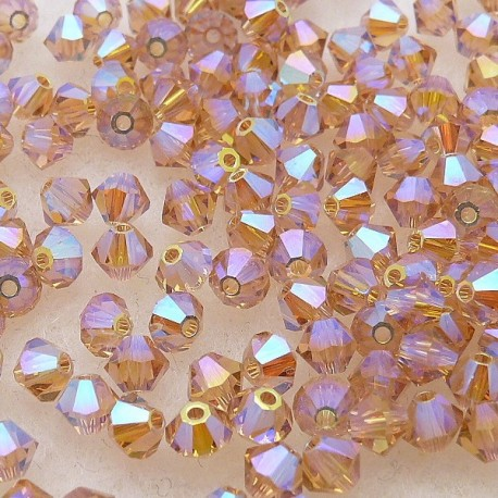 Perles Swarovski Toupies beige light colorado topaze 2X 4mm qu50