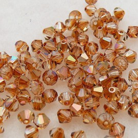 50 perles Swarovski Toupies cuivre copper AB 4mm